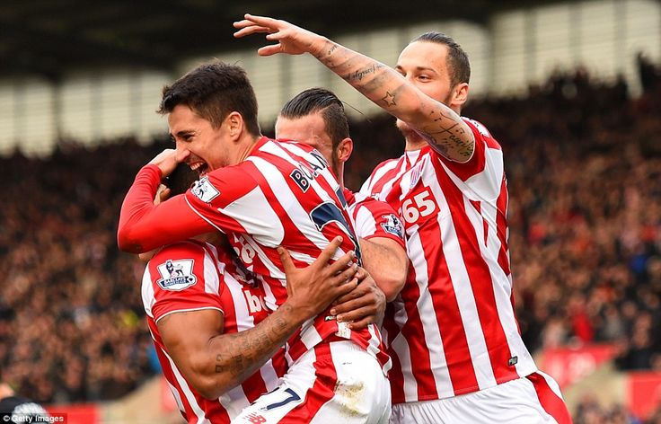 Bojan Krkic shares his delight with team-mates after setting Stoke City off on the way to ...