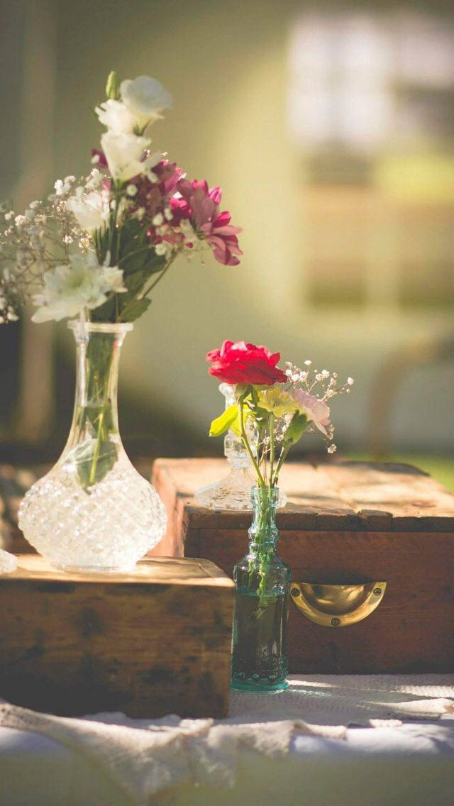 Vintage glassware with wild flowers Vintage country wedding