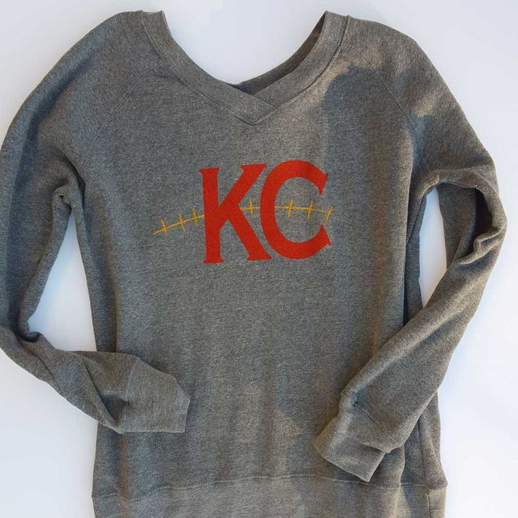 What's better than a comfy cozy sweatshirt? One that has a vneck and celebrates your favorite football team! The KC Football sweatshirt is the perfect example of less is more. The simple design is sur