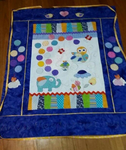 Baby cot quilt.  Hand applique.   Verigated thread... almost finished.   Joy Ott designs