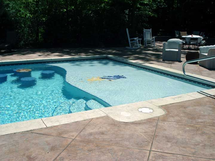Inground pool with sundeck and sunk in table and chairs for Pool platform ideas