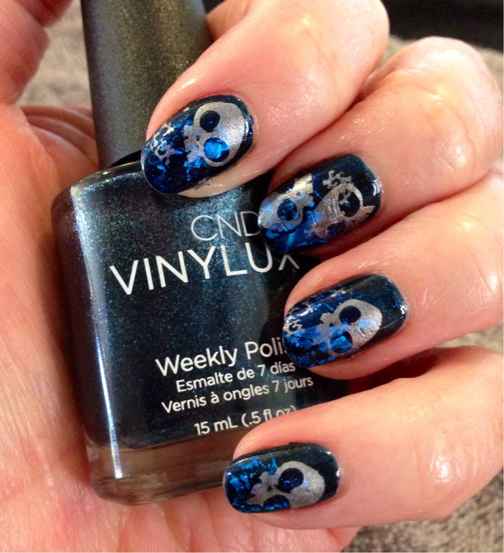 Inspirational photo by Gina Cella. A fun fall look with CND Vinylux in Midnight Swim, transfer foil, CND Additive in Deep Blue and BM Stamping Plate 225 #cndworld #cndforbiddencollection @Bloom.com