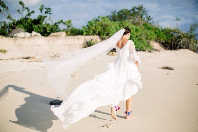 Beach Wedding Candid Photography featuring floral ankle chains : Leezette Photography