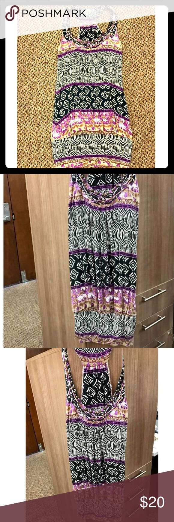 Halter Guess Dress Size Medium Beautiful, lovingly worn multicolored Guess dress! This dress has faded some, but is still absolutely gorgeous, stylish and flattering. Around the collar there are wooden beads and the dress has an almost tribal feel to it. In addition, the bottom is slightly fitted to give the dress a sexy look. This dress is perfect for a night out on the town or for a dinner date! Guess Dresses