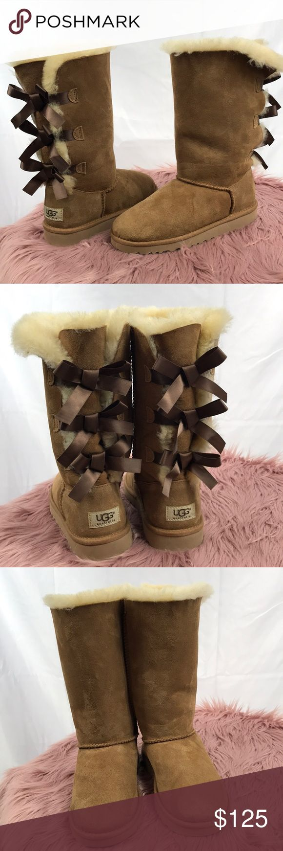 UGG Chesnut Bailey Bow Tall Boot NEW WITH MINOR DEFECTS. 100% AUTHENTIC.   - Color: Chesnut - Embellished with fixed, double ribbon bows at the back, enhancing the defining features of an UGG Classic.  - Twin-faced sheepskin upper with a suede heel guard and back lacing for added appeal - Fixed, decorative bows along back shaft - Color: Chesnut  - Size: 10   NOTE: The defect of this item is the minimal scuffs due to being packaged without a box. UGG Shoes Rain & Snow Boots