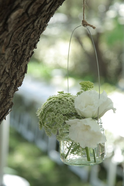 Charming flowers #wedding again I like the simplicity and unique hanging arrangement!