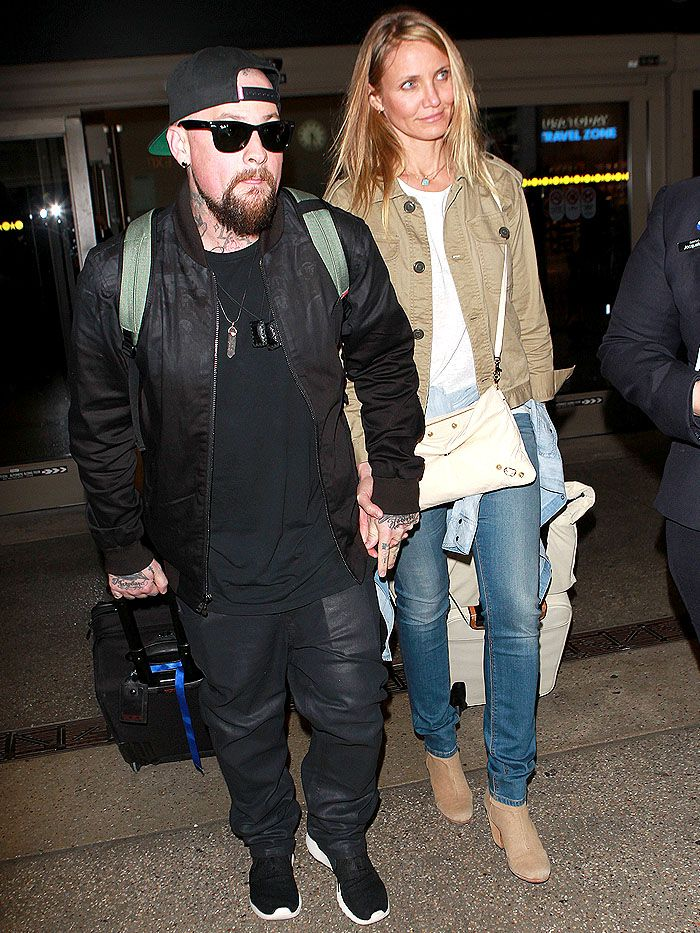 Pregnant? Cameron Diaz Wears Jacket Tied at Waist and Bag in Front upon Arriving at LAX in Rag & Bone Boots