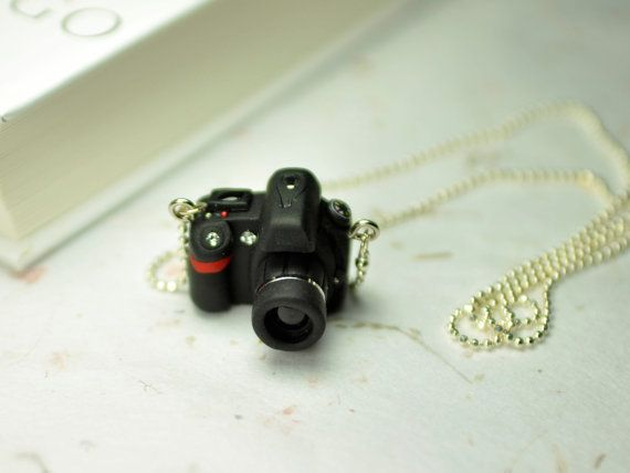 Created in a black polymer clay and little resin. This DSLR camera model is Nikon D90.    You can choose another camera model and Necklace type.    Size: