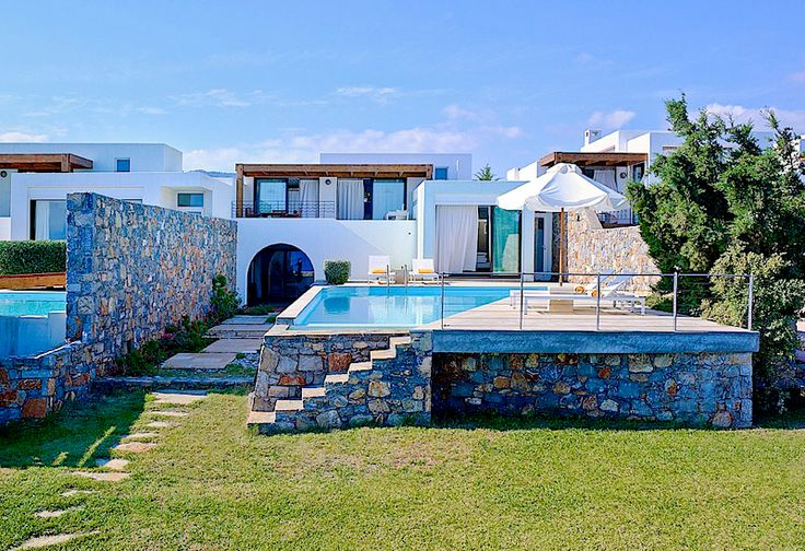 Flisvos Villa in Thalassa Villas Resort, Agios Nikolaos, Crete Island. Flisvos Villa entices guests to experience deluxe facilities and services in the incomparable secluded setting of Thalassa Villas. The spacious villa, which can accommodate