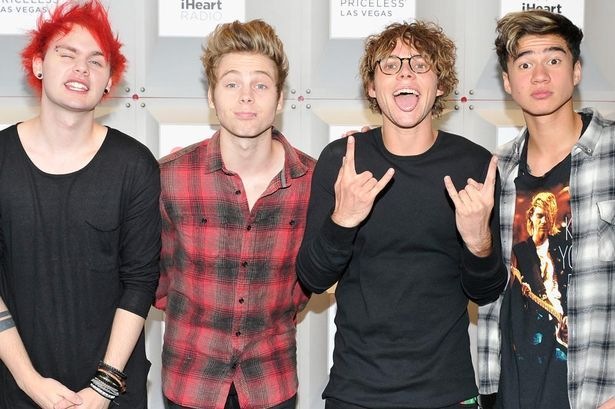 Music group 5 Seconds of Summer members Michael Clifford, Luke Hemmings, Ashton Irwin, and Calum Hood attend the 2014 iHeartRadio Music Festival at the MGM Grand Garden Arena on September 20, 2014 in Las Vegas, Nevada.