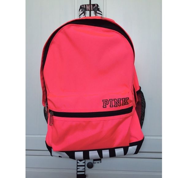 RARE NWOT Victoria's Secret PINK Backpack Neon Hot Pink backpack has many Compartments: padded labtop sleeve, 2 exterior water bottle pockets, 4 zippered sections, 4 sectioned interior compartments. Comfy/adjustable shoulder straps.  I purchased this backpack but never used it. Just had it stored and got those back marks shown on the last picture on the PINK Logo.  Open to reasonable offers through the offer feature! No low ballers please!! No trades. PINK Victoria's Secret Bags Backpacks