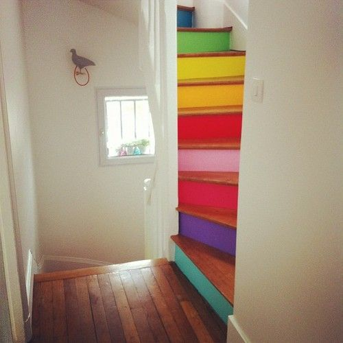 colorful stairs in a kid's area. I want to have a house like this and these stairs lead up to their playroom