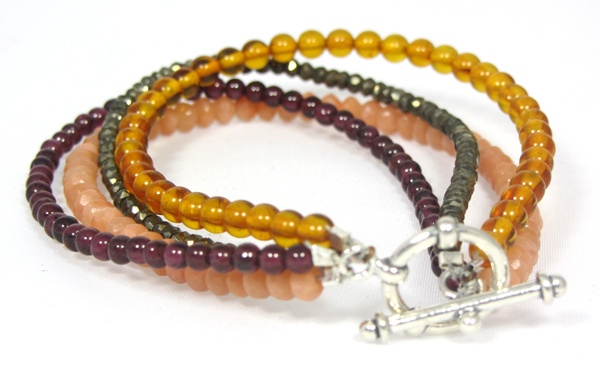 AllSpice Bracelet -   Handmade by Native Jewellery using Peruvian Pyrite, Amber, Garnet, Red Tourmaline, sterling silver toggle clasp and beads.