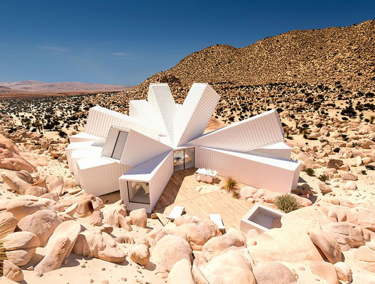 This Home Made From Stacked Shipping Containers Is Like a Flower Blooming in the Desert