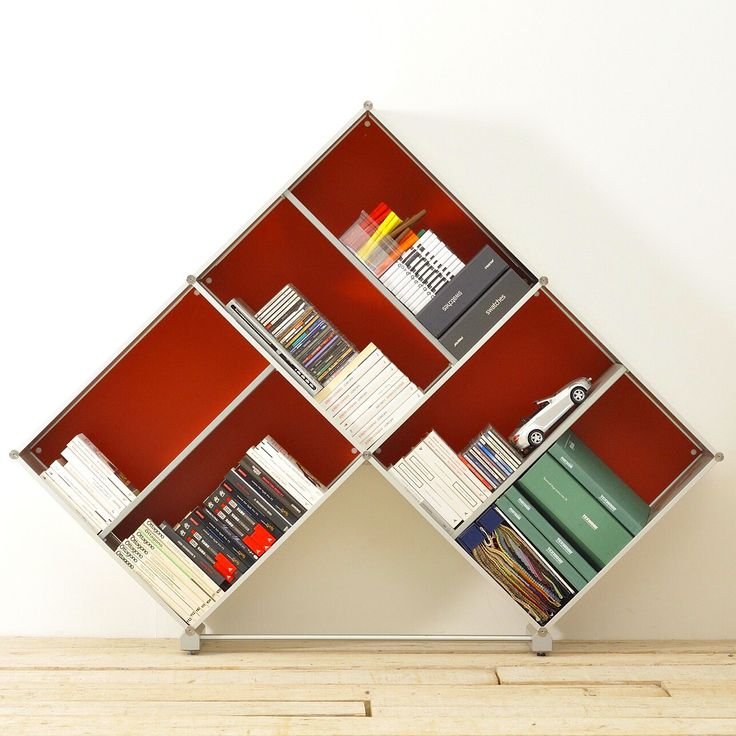 Fitting PYRAMID Mini Bookcase made in aluminum Silver email:info@piarotto.com. LEARN MORE http://www.piarotto.com ask for custom bookshelves. . . . . . . #libreria #bookcase #shelving #interiordesign #etagere #estante #bücherregal #homeoffice #bookshelf #aluminum #madeinitaly #handmade #handcrafted #interiores #interiordesign #shelves #bookshelves