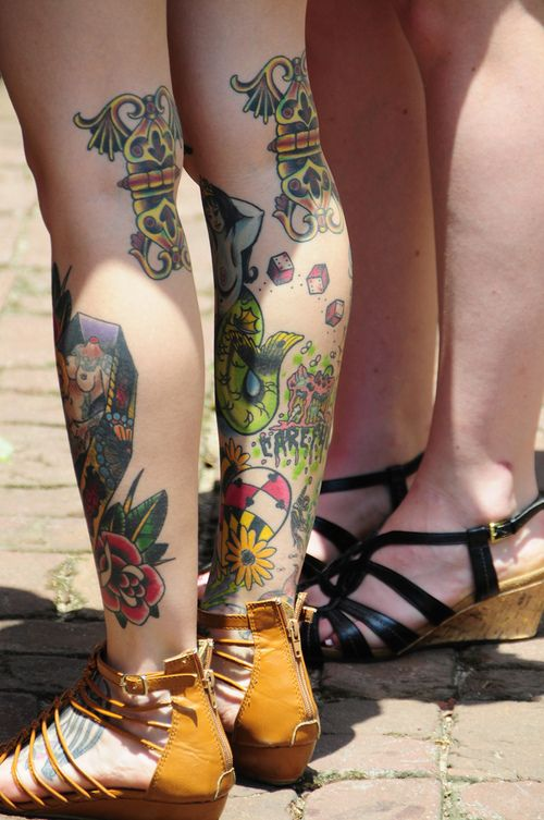 Tattoos on the legs of this lady. tattoo tattoos tattoo design tattoo