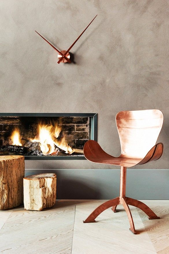 Modern copper furniture, and fireplace.