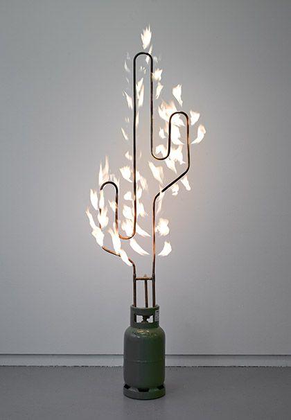 Marc Bijl: Burning Cactus, 2012. Metal cactus, glass bottle. Photo: Gert Jan van Rooij.