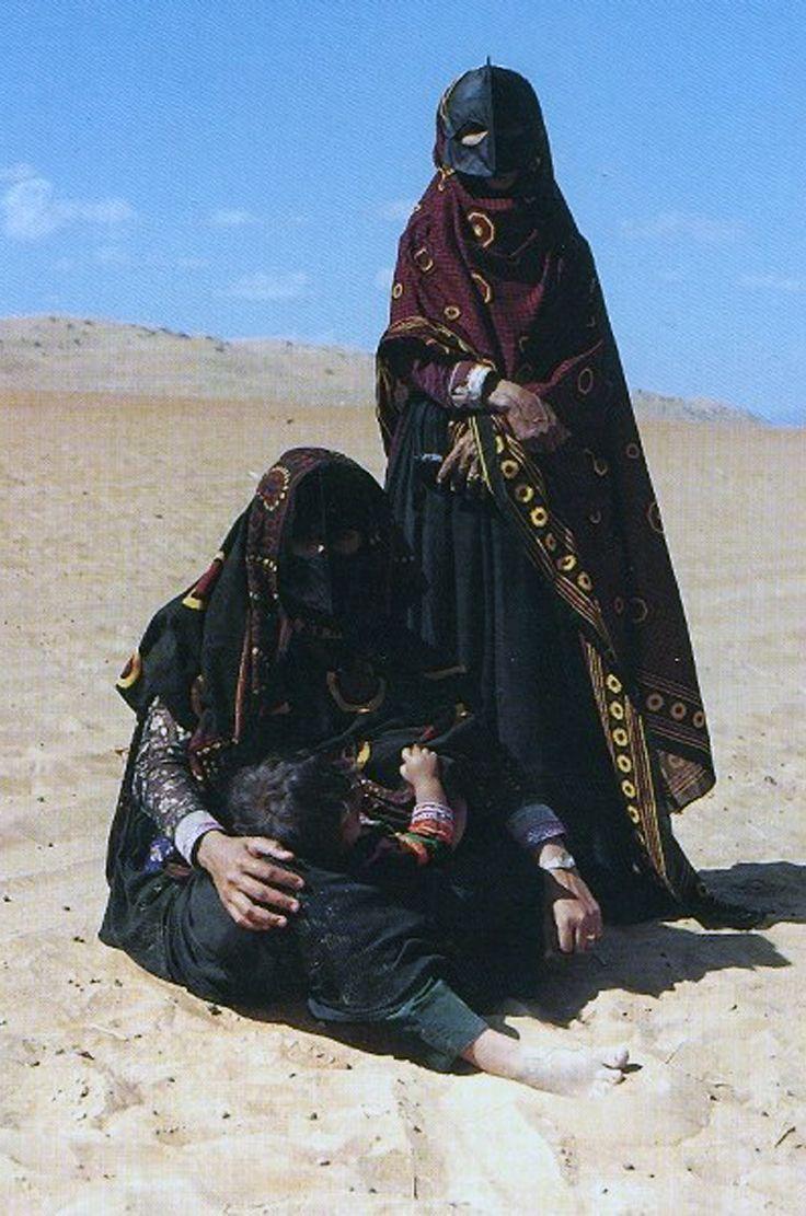 Oman and Saudi Arabia | Wahhabi women and child || Photographer unknown
