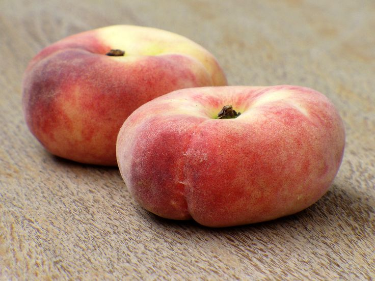 Flat peaches, such as the Saturn, took more than a century to catch on in the United States. Credit: Wikimedia Creative Commons