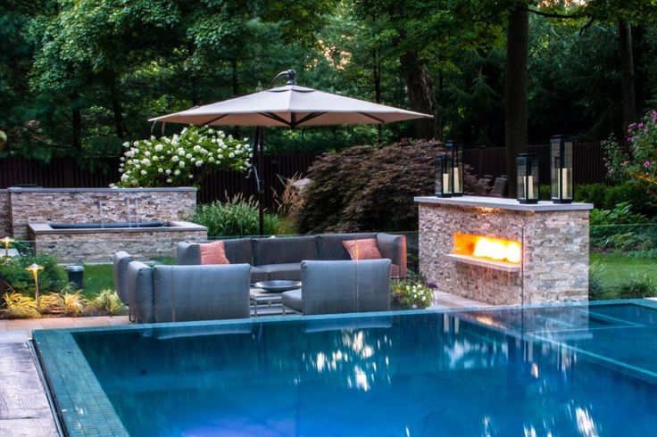 Swimming Pool:Adjustable Swimming Pool Landscaping Ideas With Blue Leather Sofa Also Stone Fireplcae Also Clear Glass Fence Cool Swimming Pool Ideas for Perfect Home Design Standard