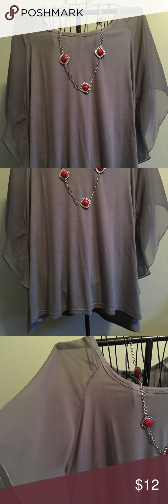 Sweet and simple! EUC ladies plus size top. Sheer sleeves with a knit bodice. Slight assymetrical hem. ashley taylor Tops Blouses