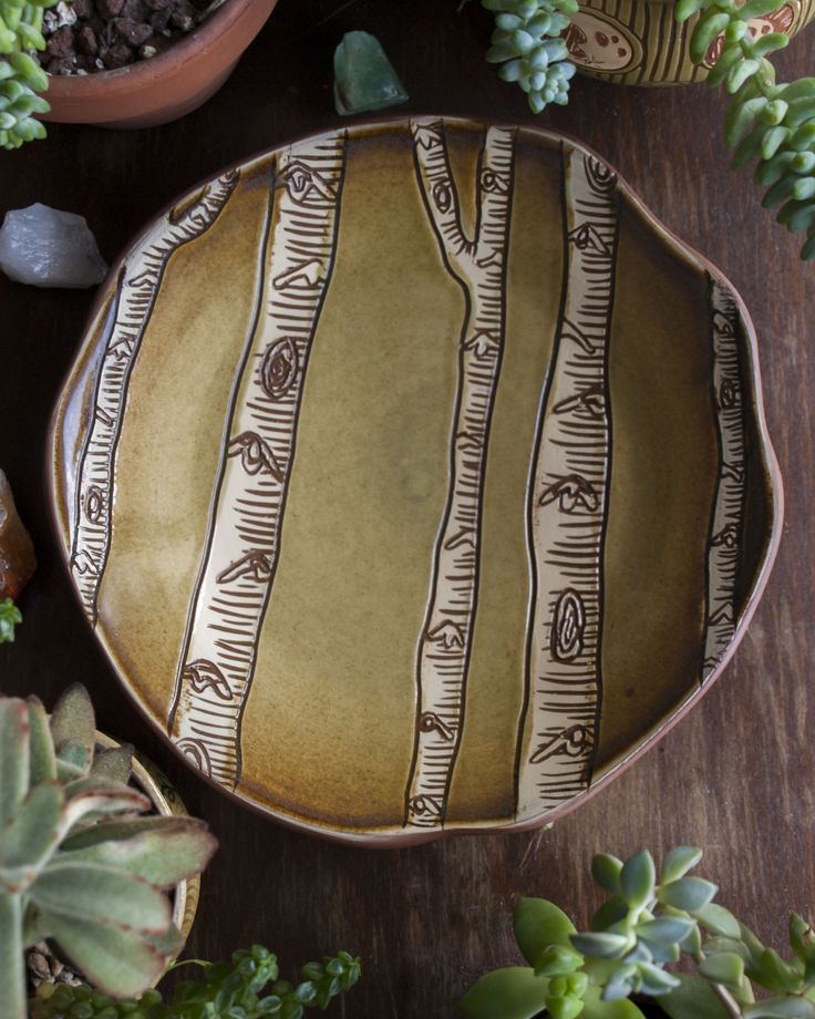 Red stoneware plate I made and designed with sgraffito birch trees. #pottery…
