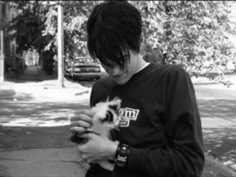 Conor Oberst holding a cat, my heart just exploded.