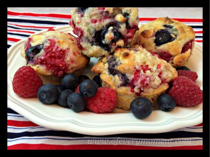Red raspberries, white chocolate and blueberry muffins.