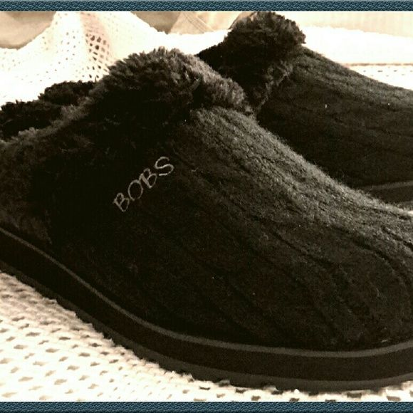 BOB'S from Sketcher's Slippers NEVER WORN! Black sweater knit material slippers! Faux fur, fluffy and soft, lines entire inside. Memory foam foot bed, rubber sole with some traction. Never been worn. Tried on once (w/ nylons) in the store. Never ended up wearing, though. I normally wear a sz 8.These are tagged 8.5 but they run a little bit narrow! So these would fit someone w/ a foot a bit smaller than an 8.5! Perfect indoor/outdoor slipper. Firm (at more than 50% off) BOB'S by Sketcher's…