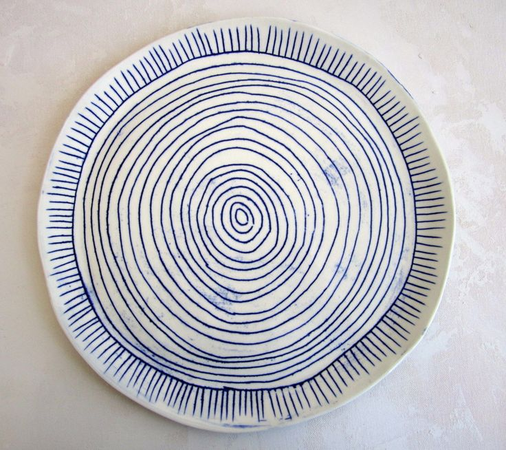 Inspiration. Paula Greif Ceramics. $120 Image of hand drawn blue and white porcelain plate