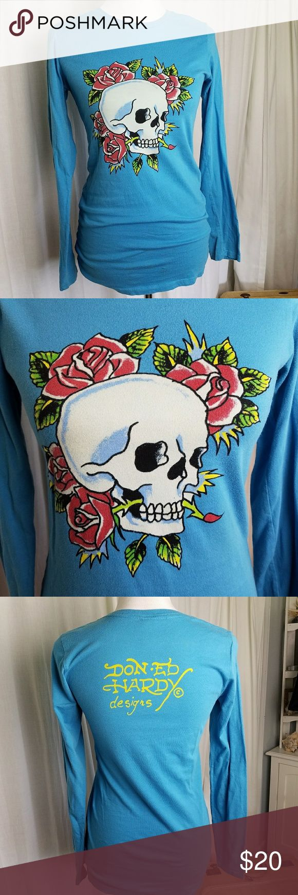 """Ed Hardy Long Sleeve Top Ed Hardy long sleeve top. Women's size MEDIUM Turquoise blue with skull and roses print. Don Ed Hardy Designs logo on back.  Gently pre-owned, with no rips, holes or stains noted  Fabric Content: 100% cotton  Measurements (lying flat): Chest (armpit to armpit): 16"""" Length: 29"""" Ed Hardy Tops Tees - Long Sleeve"""