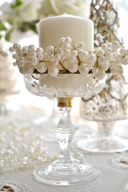 Crystal Glass, White Candle and White Pearls for an elegant table setting.