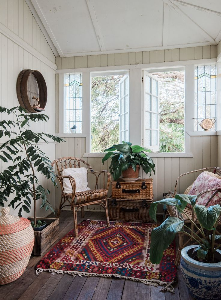 Warm colors, wood tones and a bounty of house plants make up the elegantly…