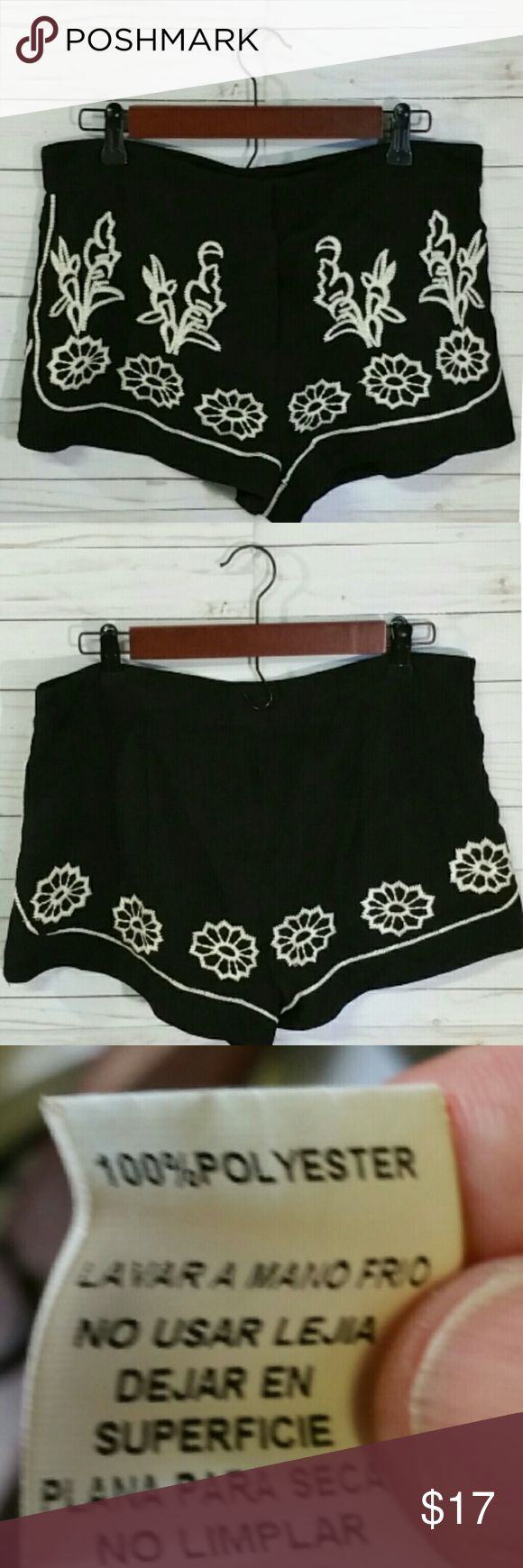 Tinley shorts, black with off white embroidery Black with off white embroidery  Zip front Size medium 32 waist 2 inseam All measurements are approximate   I offer a bundle discount check out my other listings !   Thanks for looking! Tinley Shorts