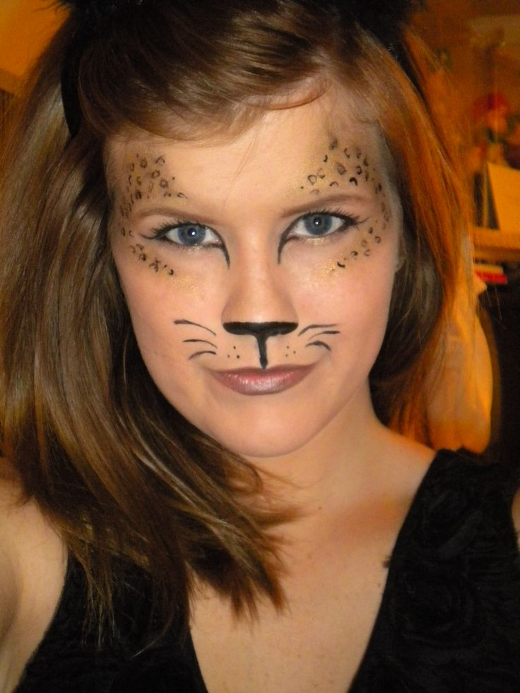 Super easy leopard makeup look for Halloween. Use black paint for the nose. Use gold eyeshadow around the eyes and then take a fine-line black liquid liner and make little 'c's and circles inside the gold shadow. :)