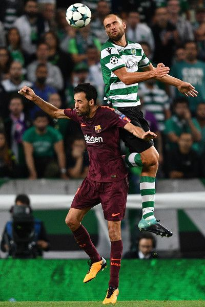 Bas Dost of Sporting CP competes for the ball with Sergio Busquets of FC Barcelona during the UEFA Champions League group D match between Sporting CP and FC Barcelona at Estadio Jose Alvalade on September 27, 2017 in Lisbon, Portugal.