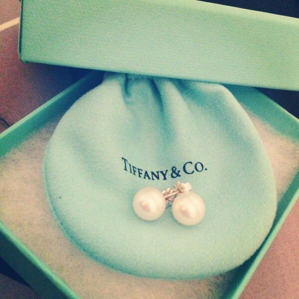 Real pearl earrings with not cheap metal studs. Not necessarily Tiffany