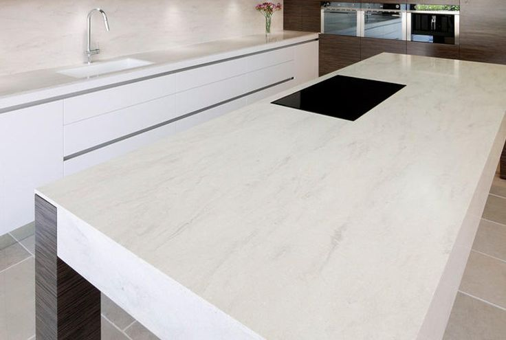 Corian® colour: Clam Shell  Application: Benchtops and splasback with Glacier White 966 sink  Design by: Art of Kitchens