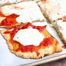 Low Carb - This almond flour pizza crust recipe is gluten-free and grain-free; thin, crisp, and holds up to any toppings.