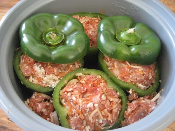 In the crock!  A healthy stuffed pepper recipe, loaded with veggies in the ground beef mixture.  I wanna try these!