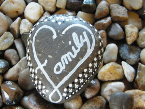 A picture is worth a 1,000 words, even on rocks. Add a touch of color to any space. Family Heart designed with white hand painted lettering into