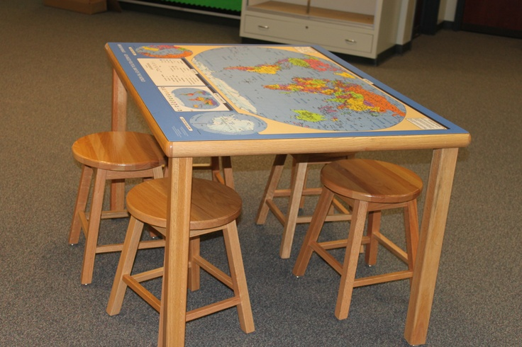 Wood tables and seats warm up any room - a map over the surface of the table has many uses throughout the curriculum. Stools are stored under the table when not in use.