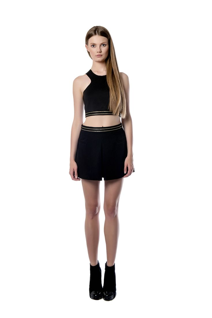 Mini - length crepe skirt  A mini – length crepe skirt detailed with gold slim lines in the waist is perfectly combined with a cropped designed glistening top which define your waist. Complete the style with gold accessories.