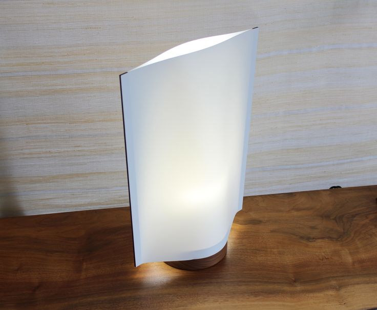 KAZE (Wind) Table Light by local artist Seiji Kuwabara.  The synthetic paper shade and walnut base gives off a cool toned ambience. $240 #homedecor #lighting
