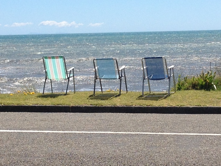 Loved this! Three chairs reserved for customers from the dairy (milkbar) across the road from Paekakariki Beach.