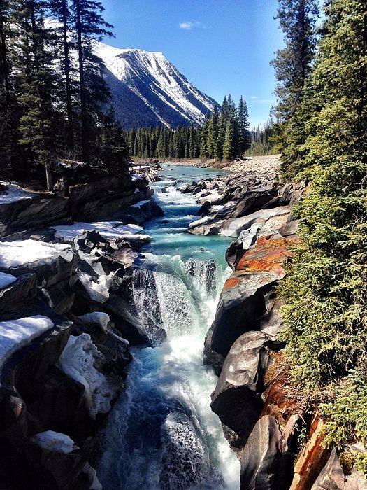 The teal waters of Numa Falls in British Columbia, Canada
