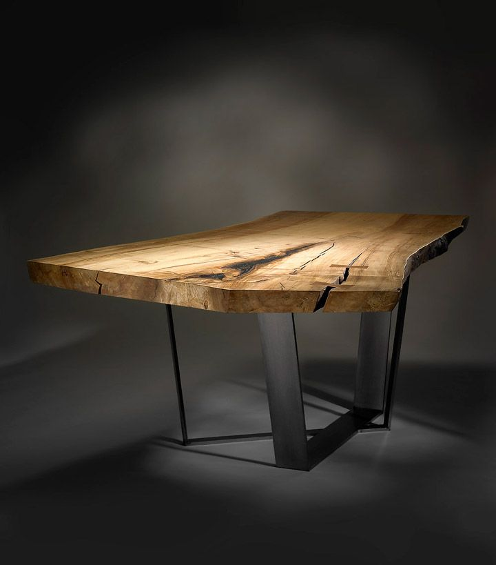 The Neiman Table is a naturally oiled, spalted maple slab paired with a custom steel pedestal base. Traditional mahogany bow-tie joints and resin stabilize natural cracks in the wood. The pedestal is powder coated clear and installed to the underside of the slab using countersunk, stainless steel machine fasteners.