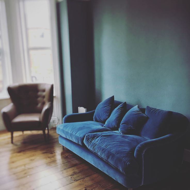 Made.com chair and Loaf velvet sofa with Oval Room Blue Farrow & Ball walls in a Victorian terrace, Dublin