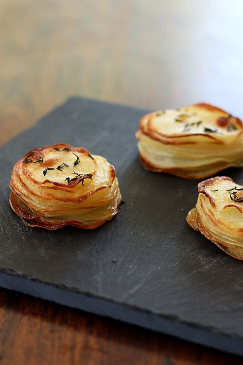 Potato Gratin in a muffin pan.  Add shredded cheese and freshly chopped chives.